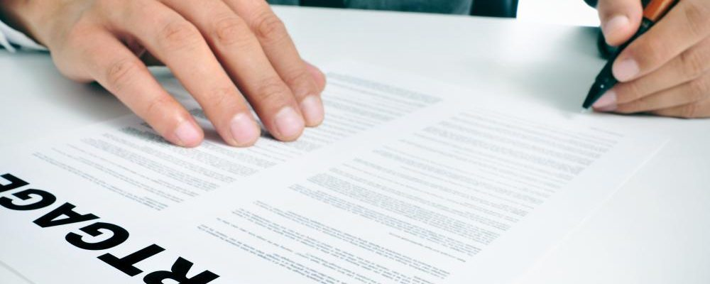 man-signing-mortgage-document